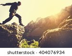 man running on mountains... | Shutterstock . vector #404076934