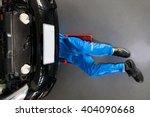 mechanic in blue uniform lying... | Shutterstock . vector #404090668