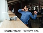 man sitting at the table with... | Shutterstock . vector #404095426