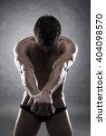 handsome muscular bodybuilder... | Shutterstock . vector #404098570