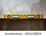 Small photo of Construction tool Bubble spirit level on line at concrete background. Copy space for text