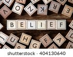 Small photo of the word of BELIEF on building blocks concept