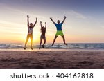 happy friends jumping on the... | Shutterstock . vector #404162818