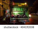 garbage truck on a night shift | Shutterstock . vector #404192038