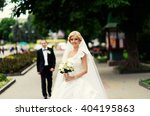 happy bride and groom on their... | Shutterstock . vector #404195863