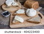 homemade cheese on sliced bread ... | Shutterstock . vector #404223400