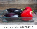sweet peppers and eggplants lie ... | Shutterstock . vector #404223613