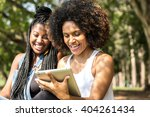 Afro Women Using Tablet...