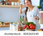 cooking woman in kitchen with... | Shutterstock . vector #404264140