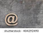 email symbol on grunge wood... | Shutterstock . vector #404292490
