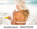 Woman Applying Sunscreen On A...