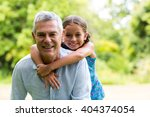 smiling grandfather carrying...   Shutterstock . vector #404374054