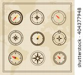 vector wind rose on a world map ... | Shutterstock .eps vector #404377948