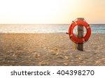 Life Preserver On Sandy Beach...