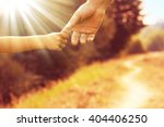 the parent holds the hand of a... | Shutterstock . vector #404406250