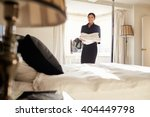 chambermaid carrying linen in... | Shutterstock . vector #404449798