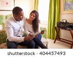 young couple study a guide... | Shutterstock . vector #404457493