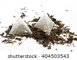 tea bags and loose green tea on ... | Shutterstock . vector #404503543