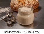 sourdough starter with loaf of... | Shutterstock . vector #404531299