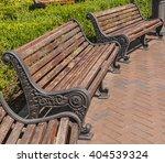 Benches In A Public Garden A...