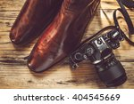 vintage camera and men's shoe... | Shutterstock . vector #404545669