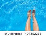 Female Legs In Blue Water Pool