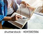 young woman reading text book... | Shutterstock . vector #404580586