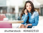 beautiful girl sitting in cafe... | Shutterstock . vector #404602510