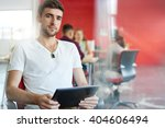 confident male designer working ... | Shutterstock . vector #404606494