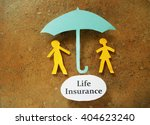 paper couple under and umbrella ... | Shutterstock . vector #404623240