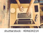 woman typing on computer... | Shutterstock . vector #404634214