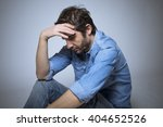 depressed man studio shot | Shutterstock . vector #404652526