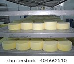 cheese production at dairy farm | Shutterstock . vector #404662510
