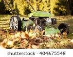 Green Lawn Mower In The Garden...