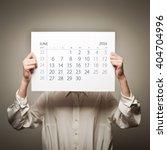 woman is holding june calendar... | Shutterstock . vector #404704996