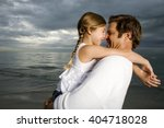 a father and daughter on a beach | Shutterstock . vector #404718028