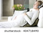 pregnant woman relaxing whilst... | Shutterstock . vector #404718490
