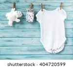 baby boy clothes and white toy... | Shutterstock . vector #404720599