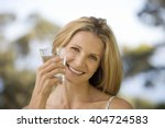 woman holding a glass of water | Shutterstock . vector #404724583