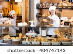 helpful bakery staff offering...   Shutterstock . vector #404747143
