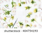 Stock photo empty paper blank with pink roses petals yellow flowers and paint brush on white background flat 404754193