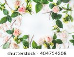frame with pink roses  branches ... | Shutterstock . vector #404754208
