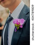 pink orchid boutonniere on the...   Shutterstock . vector #404789809