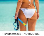back of young woman in bikini... | Shutterstock . vector #404820403