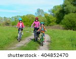 happy mother and kids on bikes... | Shutterstock . vector #404852470