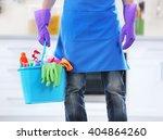 man holding plastic bucket with ... | Shutterstock . vector #404864260