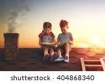 Children Reading A Book Sitting - Fine Art prints