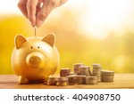 piggy bank gold color and stack ... | Shutterstock . vector #404908750