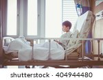 Small photo of Illness asian child admitted at modern and comfortable equipped hospital room with infusion pump intravenous IV drip. Health care and people concept. Vintage style.