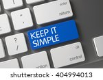 Stock photo blue keep it simple button on keyboard keep it simple written on blue key of white keyboard 404994013